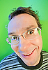 Photo 300 DPI: Funny surprised man in glasses on vivid colors