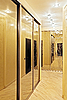Passage with mirror wardrobe in warm tones | Stock Foto