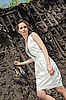 Photo 300 DPI: Lady in white sundress inside deep black ground quarry