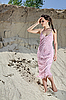 Beautiful young woman standing barefoot in sand | Stock Foto