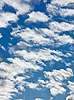 Fleecy clouds on blue sky | Stock Foto