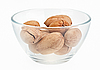 Pecan nuts in glass bowl on white  | Stock Foto