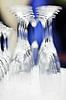 Upturned set of wine glasses on blurred blue | Stock Foto