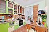 Green Kitchen interior with many utensils and window | Stock Foto