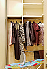 Wardrobe with clothes and ironing board | Stock Foto