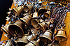 Photo 300 DPI: metal sacrificial bells hanging on chain, Kathmandu