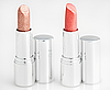 Two brown lipsticks over white | Stock Foto