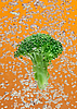 Green broccoli falling in water with air bubbles | Stock Foto