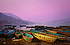 Beautiful twilight landscape with boats on Phewa lake | Stock Foto