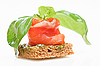 Salmon canape with basil on white   Stock Foto