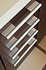 Photo 300 DPI: Brown hardwood drawers with metal handle