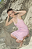 Lady in pink scaly sundress on sand quarry | Stock Foto