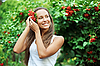 Beautiful woman with guelder rose in hair | Stock Foto