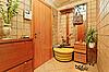 Elegance anteroom interior in warm tones with hallstand | Stock Foto