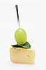 Cheese canape with grape and mint | Stock Foto