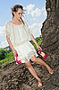 Barefooted attractive lady in white on soil quarry | Stock Foto