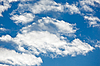 Fleecy clouds on blue sky background | Stock Foto