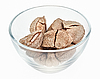 Brazil nuts in glass bowl isolated on white | Stock Foto
