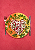 Photo 300 DPI: Valentine's day salad with beef tongue on red table-cloth