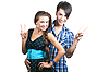 Young happy couple showing thumbs up | Stock Foto