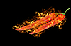 Spicy red chilli peppers at fire | Stock Foto