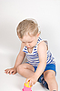 Baby boy playing with pyramid toy | Stock Foto