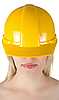 Woman in yellow building helmet | Stock Foto