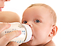 Mother feeds baby from bottle | Stock Foto