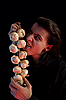 Vampire with scary eyes is licking garlic  | Stock Foto
