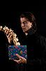Photo 300 DPI: amazed vampire with gift box taking out garlic