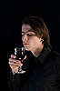 Photo 300 DPI: Handsome vampire with glass of wine or blood