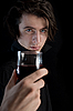 Photo 300 DPI: Handsome vampire holding glass of wine or blood