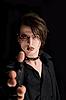 Photo 300 DPI: Gothic boy pointing his hand as gun