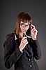 Thoughtful business woman wearing glasses  | Stock Foto