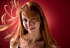 ID 3022429 | Junge Frau mit fliegenden Haaren und Sektglas | Foto mit hoher Auflösung | CLIPARTO