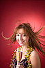 Cheerful girl with flying hair and champagne glass  | Stock Foto