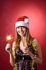 Smiling girl with Christmas sparkler  | Stock Foto