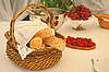 Table with bread basket and wine bottles | Stock Foto
