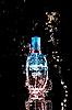Photo 300 DPI: Perfume bottle with water splashes