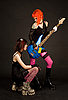 Photo 300 DPI: Two rock girls, one of them licking guitar