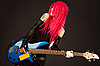 Smiling punk girl with bass guitar    Stock Foto