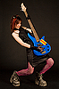 Attractive girl playing bass guitar | Stock Foto