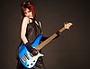 Rock girl with blue bass guitar | Stock Foto