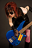 Photo 300 DPI: Urban musician with bass guitar