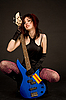 Photo 300 DPI: Beautiful girl with bass guitar