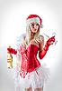 Foto 300 DPI: Mrs. Santa mit Champagner-Flasche