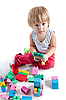Little boy playing with colorful blocks | Stock Foto