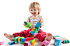 Laughing little boy playing with colorful blocks | Stock Foto