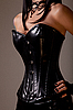 Slim sexy woman in black leather corset | Stock Foto