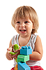 Photo 300 DPI: Laughing little boy playing with blocks